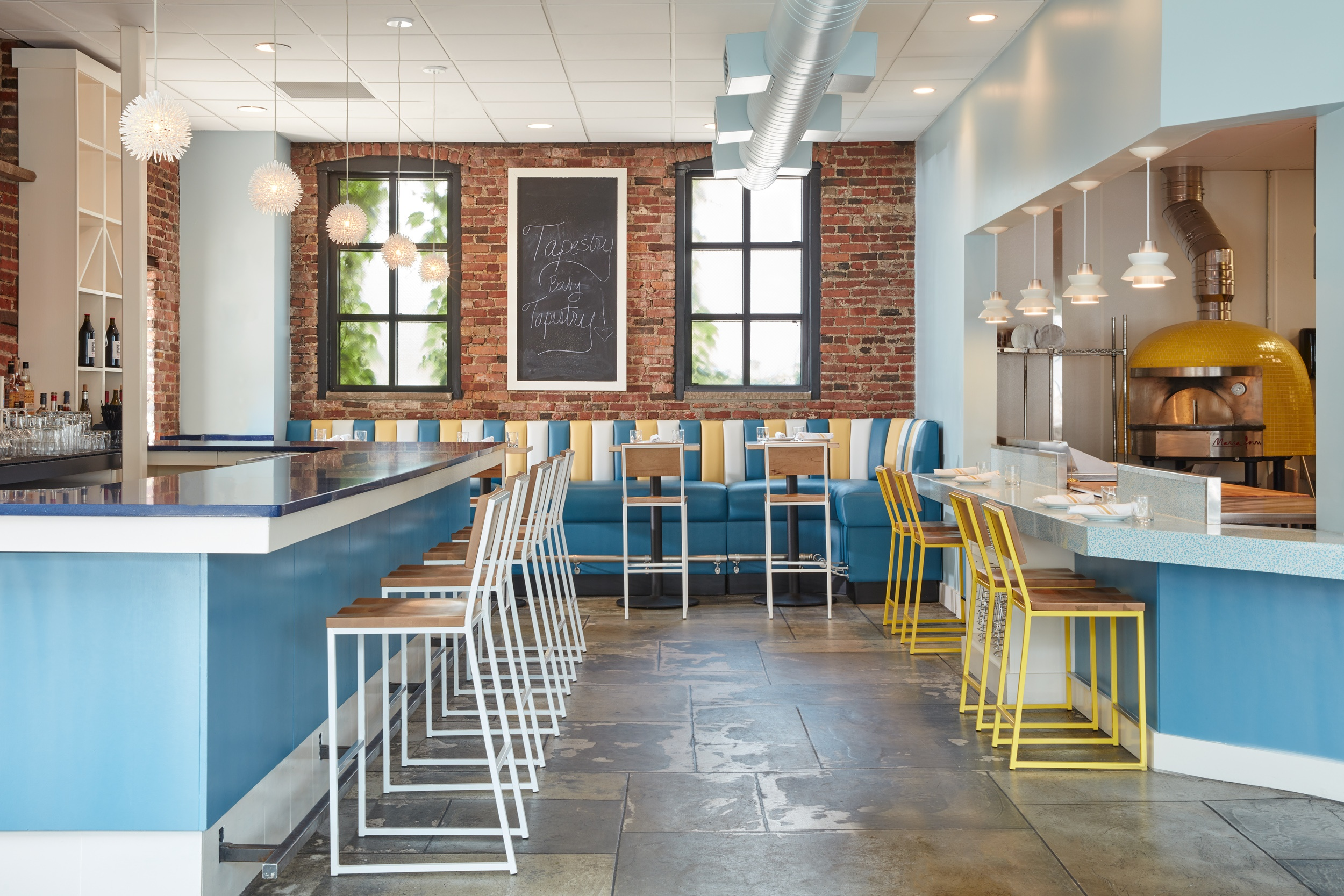 Tapestry restaurant featuring modern barstools by Grand Rapids Chair Co
