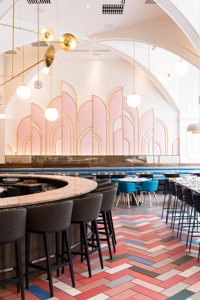 Coral Colored Floor in Art Deco Inspired Restaurant with Modern Furniture