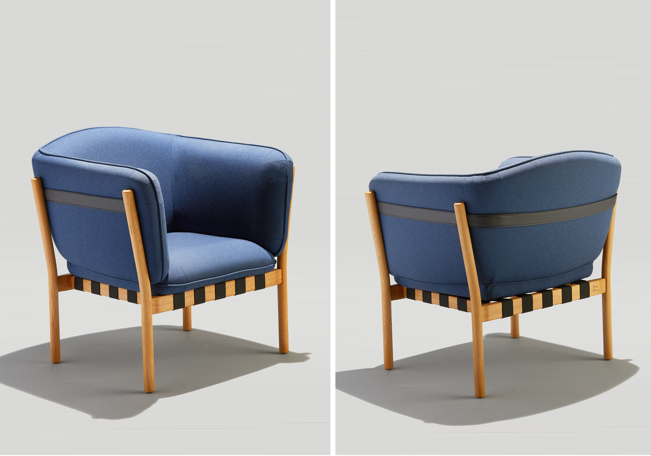 Dowel Lounge front and back with white oak legs, a black top strap and blue upholstery.