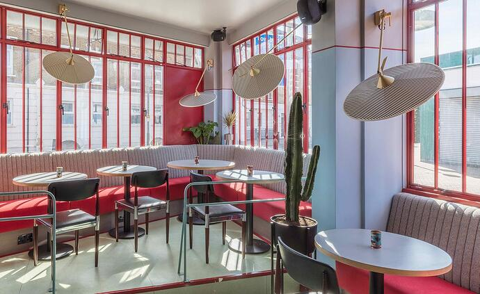 Pirana - Coral Colored Restaurant Interior With Modern Furniture