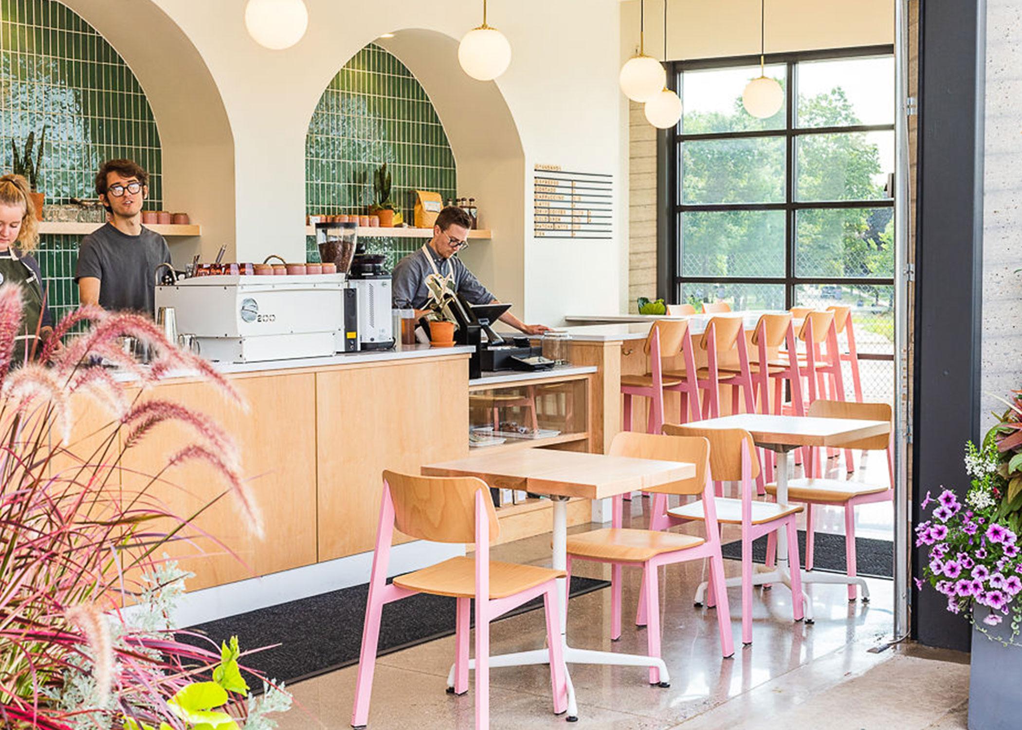 Light pink Sadie II restaurant chairs and barstools inside modern coffee shop