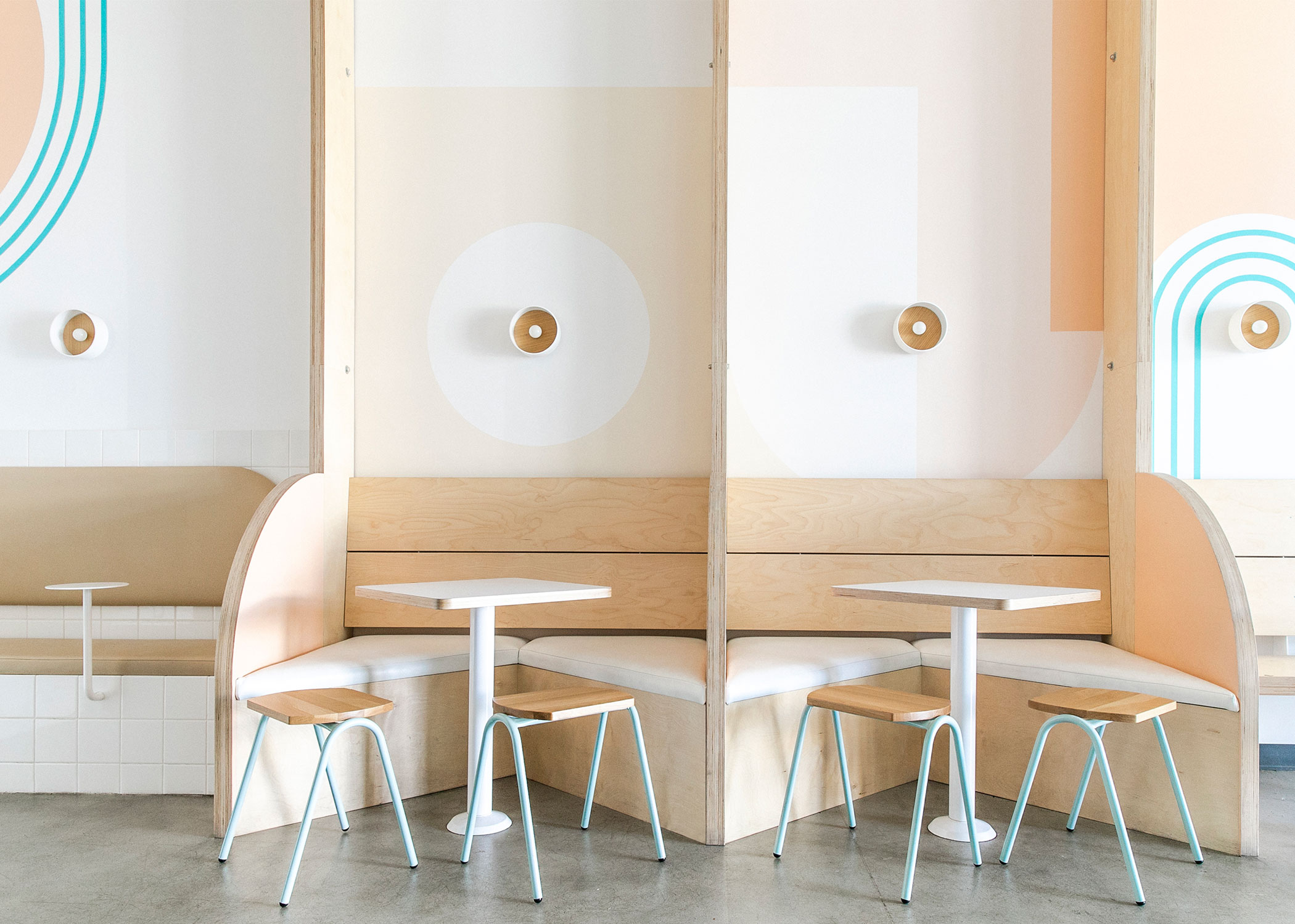 Modern stools with a dining table and custom built booth inside of Iceskimo