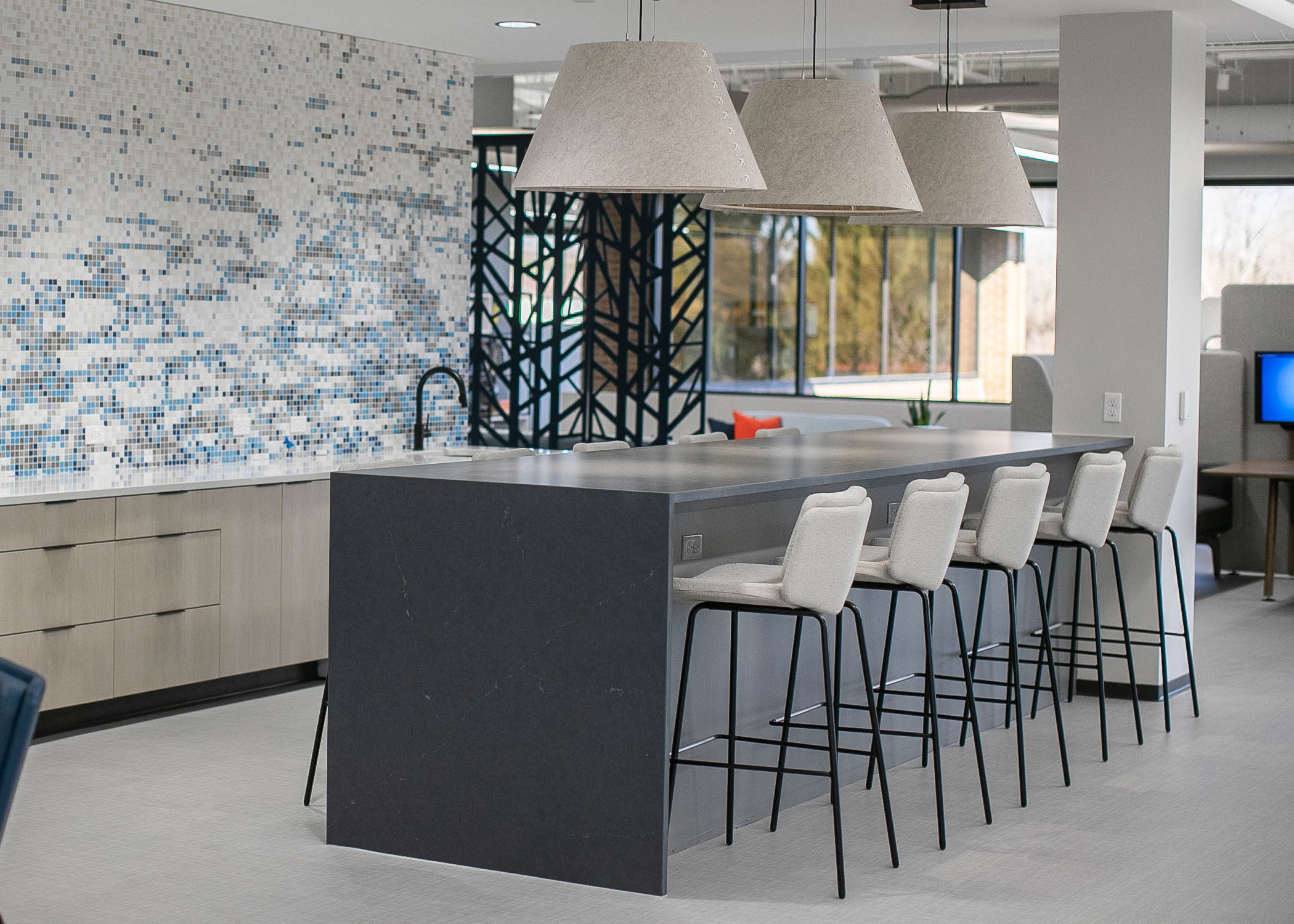Alfred barstools at a sleek countertop with hanging lighting.